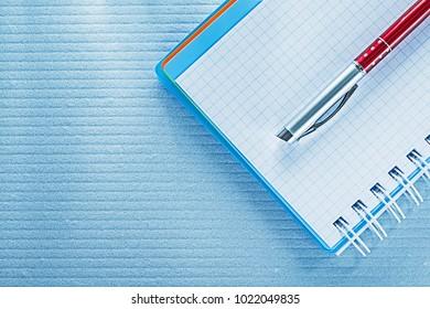 Spiral checked notebook biro pen.