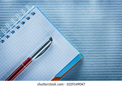 Spiral checked notepad biro pen.