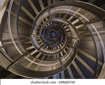 Spiral up and down - Staircase inside City Tower Innsbruck