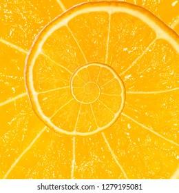 Spiral fractal mandarin orange fruit. Top view of textured ripe slice of mandarin orange citrus fruit with spiral endless skin. Endless juicy orange citrus fruit. Sea of juice concept.