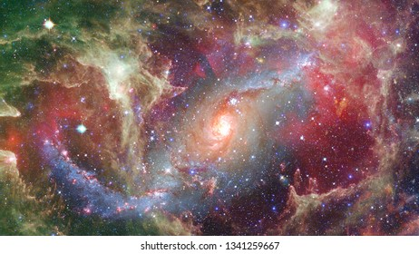 Spiral galaxy in space. Abstract background. Elements of this image furnished by NASA.