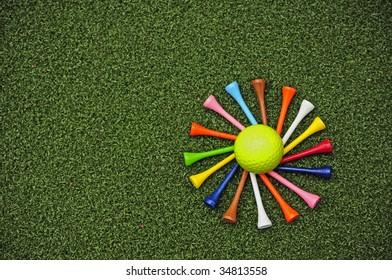 spiral of golf tees around golf ball