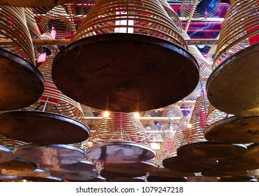 spiral incense sticks hanging from the ceiling in a pagoda in Hong Kong