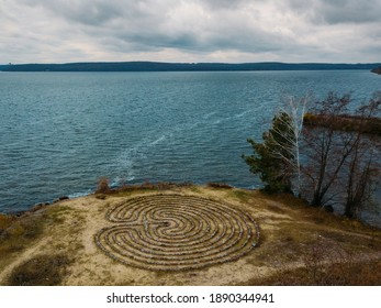 Spiral labyrinth made of stones on the coast, aerial view .