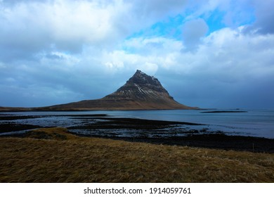 Spiral mountian (Kirkjufell) from a distance over the flat plains