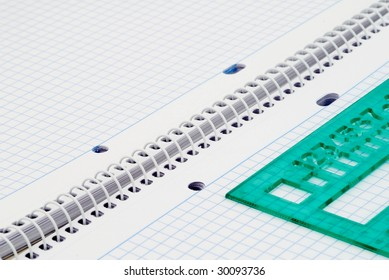 Spiral notebook with blue grid. Selective focus