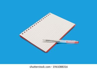 Spiralheft mit Stift auf blauem Hintergrund
