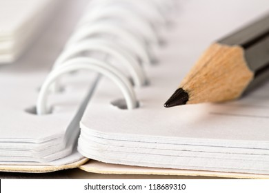 Spiral notebook and pencil
