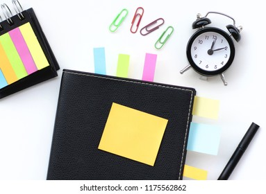 Spiral notepad with pen and different accessories as mockup for your design. White background, flat lay style.
