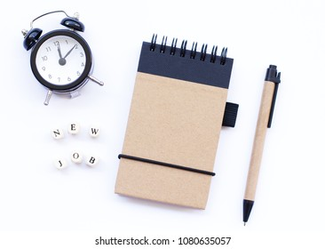 """Spiral notepad with pencil and words """"new job"""" as mockup for your design. Career employment, recruitment, business concept. White background, flat lay style."""