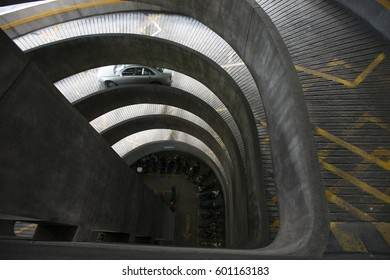 Spiral shaped entrance to the parking with car moving in