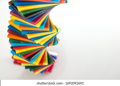 spiral Stack of different colours Cast Acrylic Sheet on white background