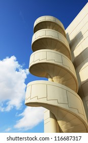 Spiral staircase against the blue sky