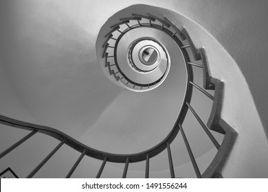 Spiral staircase in black and white from below