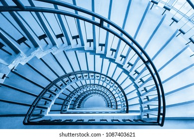 spiral staircase closeup, view from the top down, blue tone