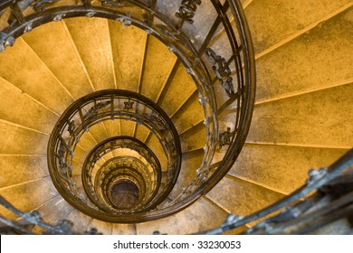 Spiral staircase, forged handrail and stone steps in old tower