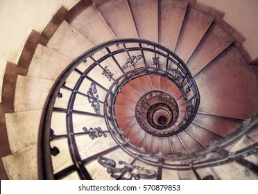 spiral staircase in an old house. spiral staircases architectural element of a historic building