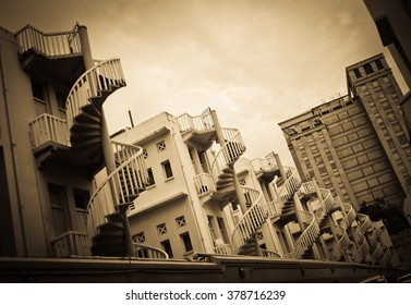 Spiral staircases at the back of traditional Chinese shop houses in Bugis Village, Singapore.