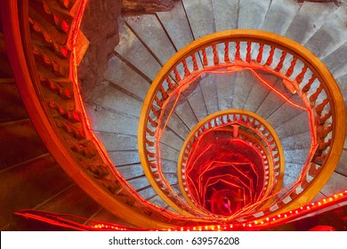 Spiral stone stairs with red painted balustrade. Buddha tample. China.