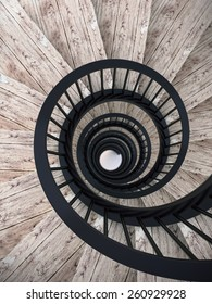 Spiral wood stairs with black painted balustrade