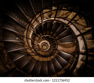 Spiraling staircase looking down from the top.  Nice abstract design.