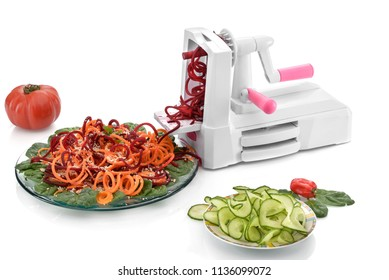 spiralizing cucumber vegetable with spiralizer isolated on white