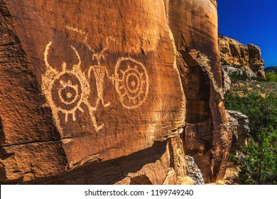 Spirals, circles, and anthropomorphs, (sometimes called ancient aliens) petroglyphs at Mcconckie Ranch in Dry Fork Canyon outside of Vernal, Utah, USA.
