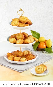 Spirals of fried pastry flavored with orange, typical Italian sweets made during the carnival period.