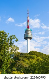 The spire of N Seoul Tower, or Namsan Tower, and the blue skies above Seoul