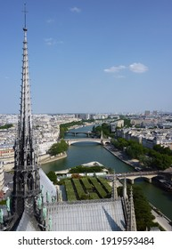 The spire of the Notre-Dame Cathedral in Paris before being destroyed by the 2019 fire gazes imperiously at the River Seine - Shutterstock ID 1919593484