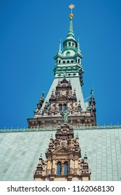 The spire of Rathaus tower on the blue sky background. Rathaus is the famous Hamburg City Hall, Germany.