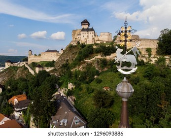 The spire of Roman Catholic Church of the Birth of Virgin Mary and the castle in Trenčín (Trencin), Slovakia, Europe