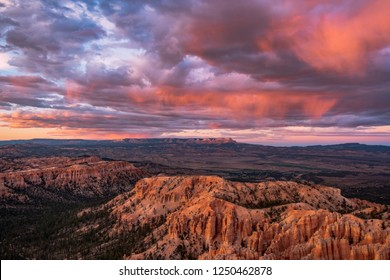 Spire shaped rock formations called hoodoos at sunrise/sunset from Inspiration Point, a viewpoint in Bryce Canyon National Park in Utah