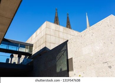 spires of the Cologne Cathedral behind the Romano-Germanic-Museum in Cologne, Germany