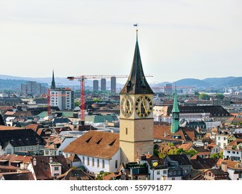 Spires of Saint Peter Church and Augustinian Church  and rooftops of the city center of Zurich, Switzerland.