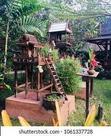 Spirit houses made from wood in rural area of Thailand.