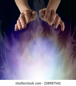 Spirit Matter - Pair of female hands hovering over a misty ethereal energy field on a black background with plenty of copy space