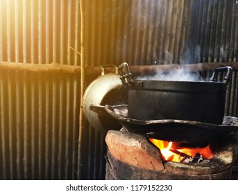 Spirit of northeast from thailand , kitchen of folk village, Cook from thai vintage style with warm light concept ,classic rustic cuisine in family,  equipment for Sticky rice from Asia , Boiled food