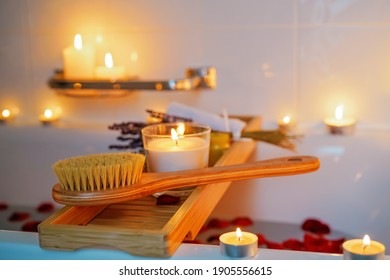 Spiritual aura cleansing flower bath for full moon ritual with candles, aroma salt, lavender and rose petals. Body care and mental health routine.