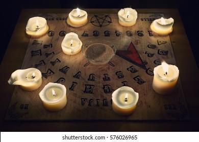 Spiritual board ouija with candles