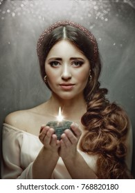 Spiritual female portrait, beauty blonde woman with candle in his hands