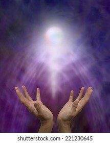 Spiritual Healing Orb  -  Healer's outstretched open hands with a glowing spirit orb rising up on a misty purple and blue background