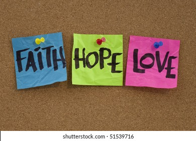 spiritual reminder or metaphysical concept - faith, hope and love handwritten on colorful notes and posted on cork bulletin board