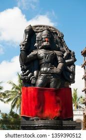 Spiritual statue of hindu god goddess sculptures in ancient temple of Tamil Nadu, India.