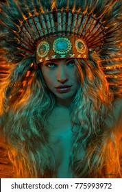 Spirituality, beautiful girl with plume of american indian feathers