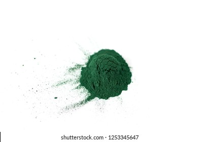 Spirulina / chlorella powder close-up, top view, isolated on white background