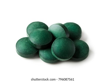 Spirulina tablets isolated on a white background