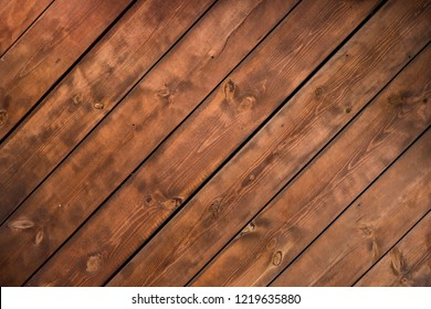 Spit lines rustic wooden texture background. Facade of a log house, copy space. Wooden texture background Wall of blockhouse