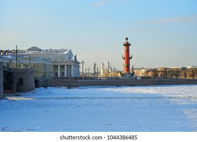 Spit of Vasilevsky island, Rostral column in winter on a Sunny day in Saint-Petersburg