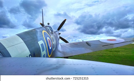 Spitfire aircaft on a cloudy day in summer on an airfield.